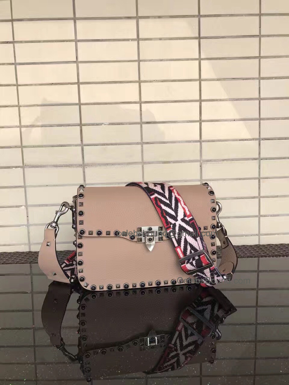 Replica Valentino Guitar Rockstud Rolling Skin Color Medium Cross Body Bag